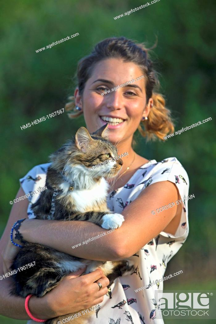 Stock Photo: France, Bas Rhin, Bischoffsheim, one person with a cat.