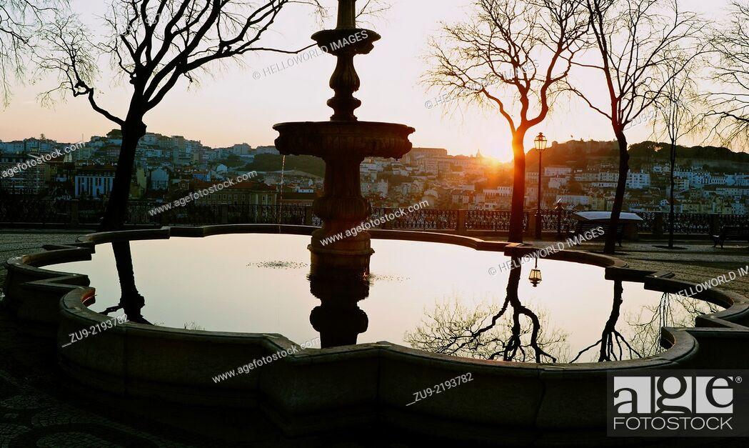 Stock Photo: Sunrise over Lisbon from Miradouro Sao Pedro de Alcantara viewpoint gardens, Portugal, western Europe.