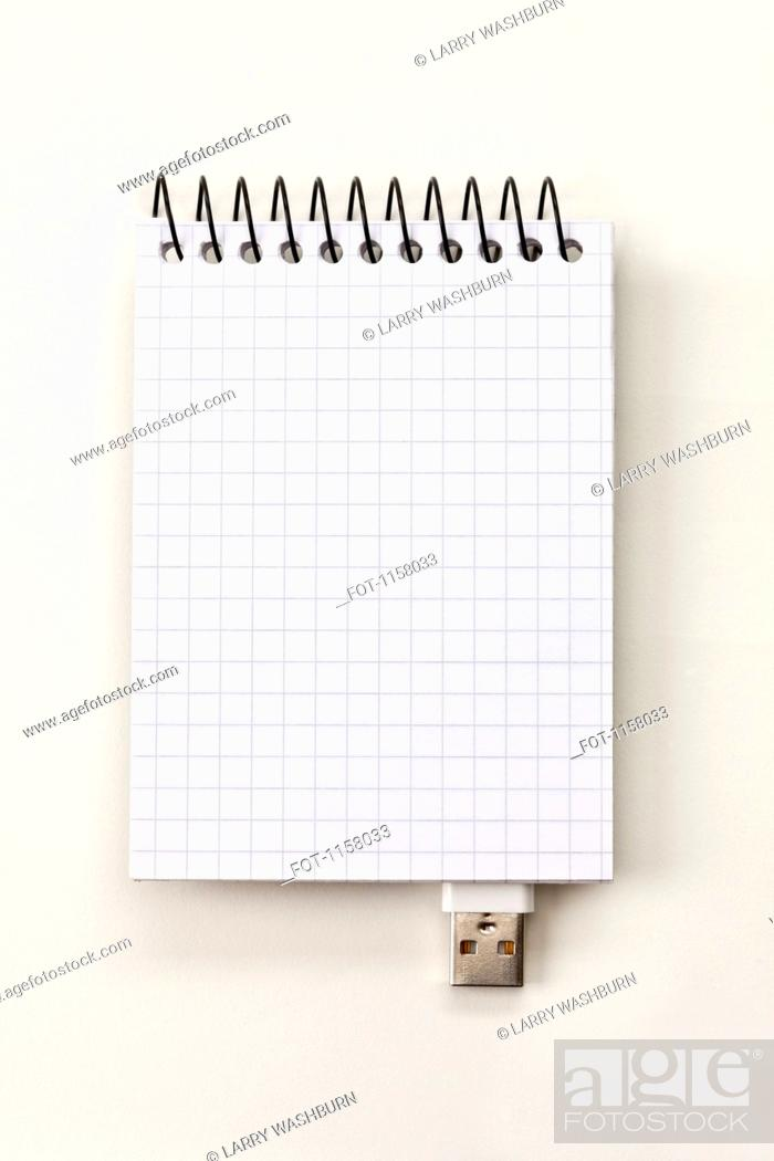 Stock Photo: A spiral notepad with USB connector imitating a USB stick.