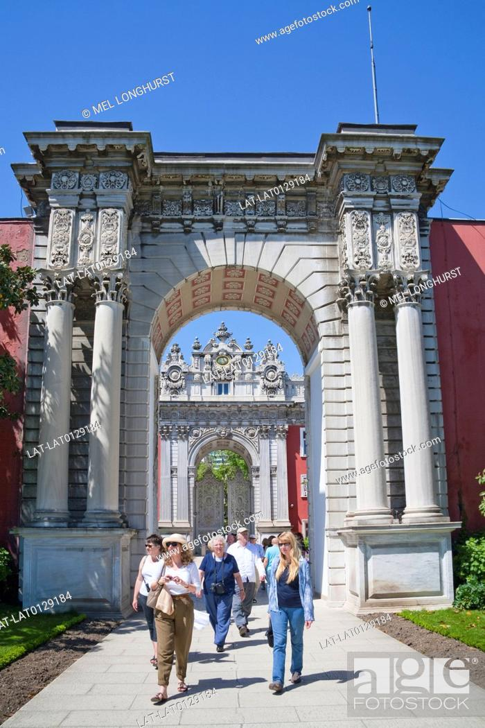 Stock Photo: The Treasury Gate, Hazine Kapisi, is a huge arch decorated in the neo baroque style on the perimeter wall of the Dolmabahce Palace on the shores of the.