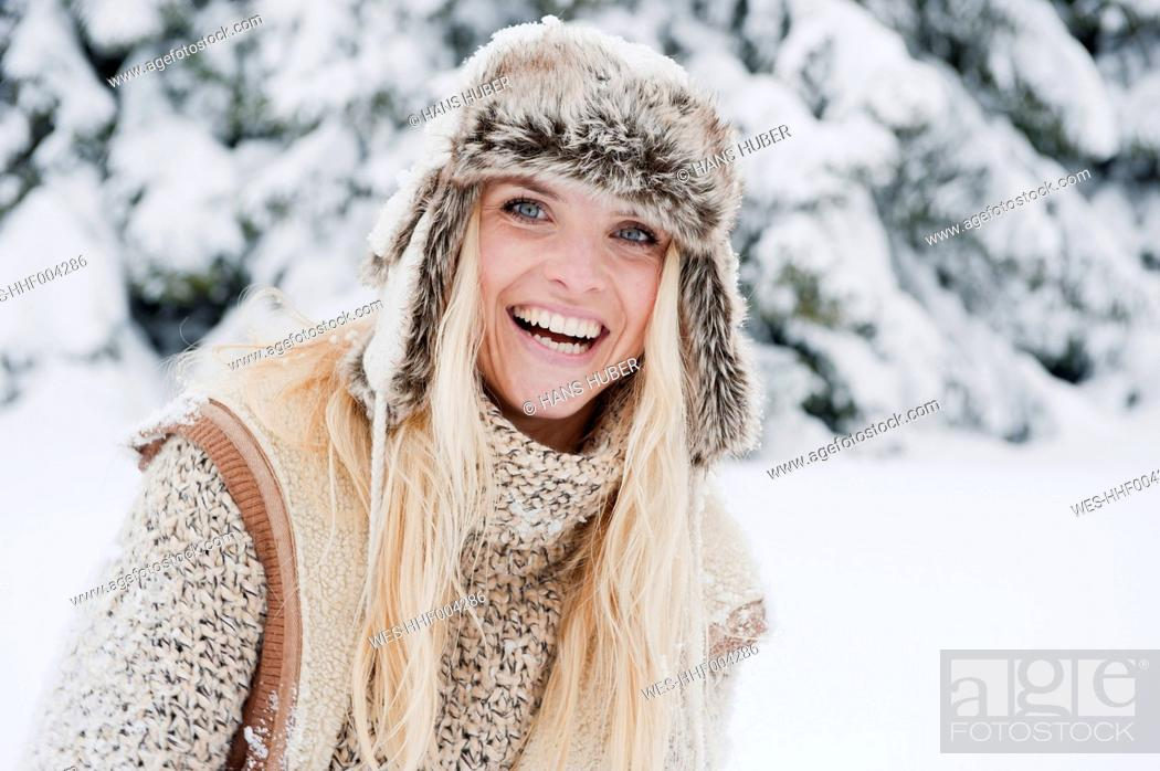 Stock Photo: Austria, Salzburg County, Mid adult woman smiling, portrait.