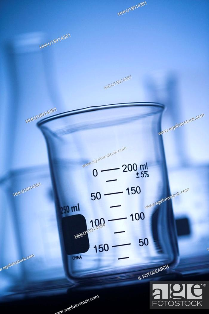 Stock Photo: Glass science container with blue tint.