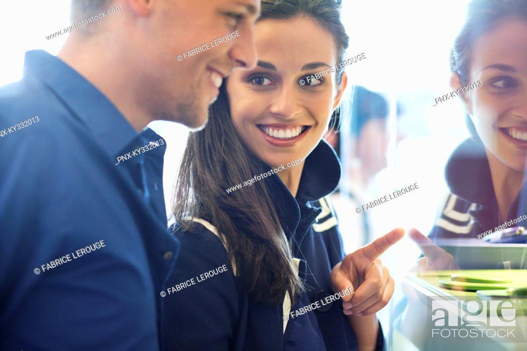 Stock Photo: Young couple doing window shopping.