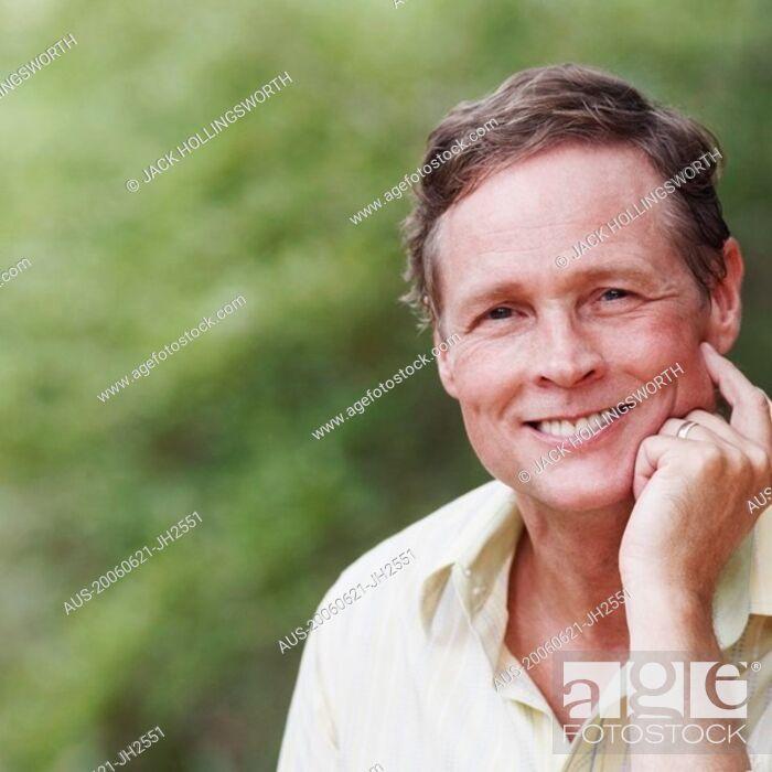 Stock Photo: Portrait of a mature man smiling.