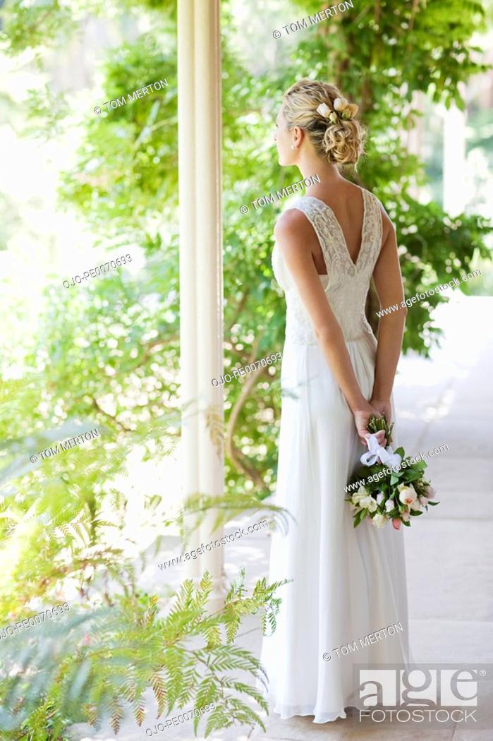 Stock Photo: Bride holding bouquet.