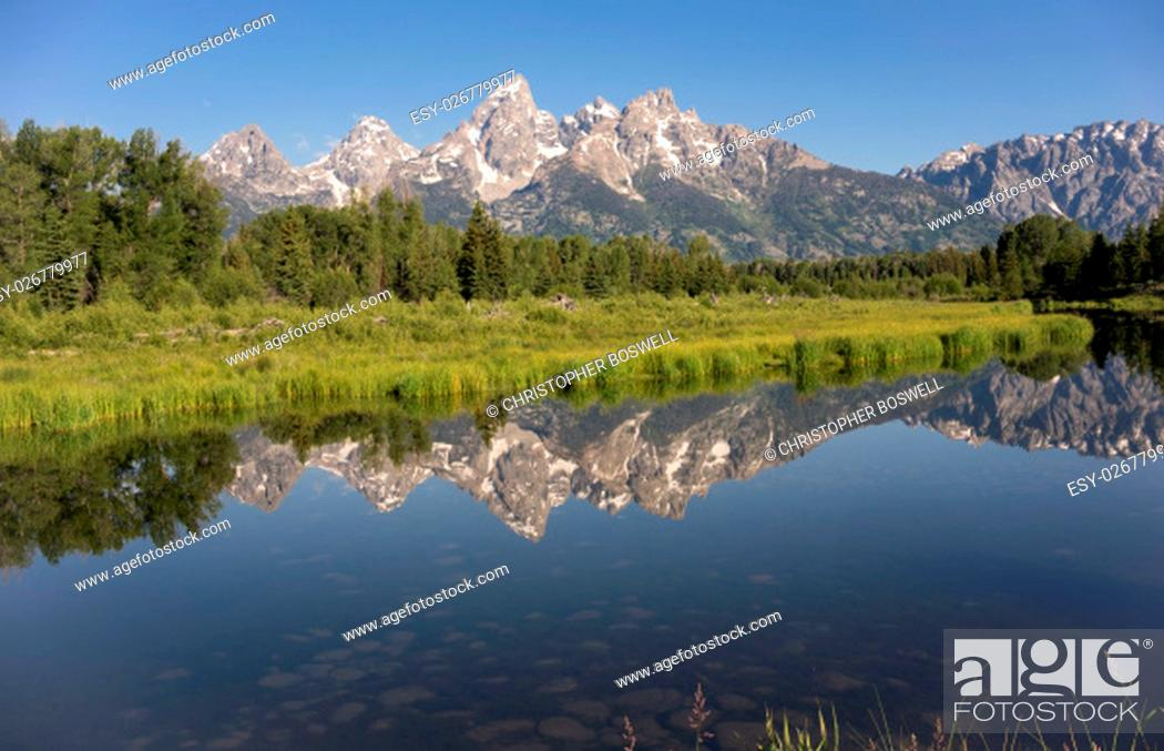 Stock Photo: Rocky Mountain Range Reflected Smooth Water Grand Teton National Park.