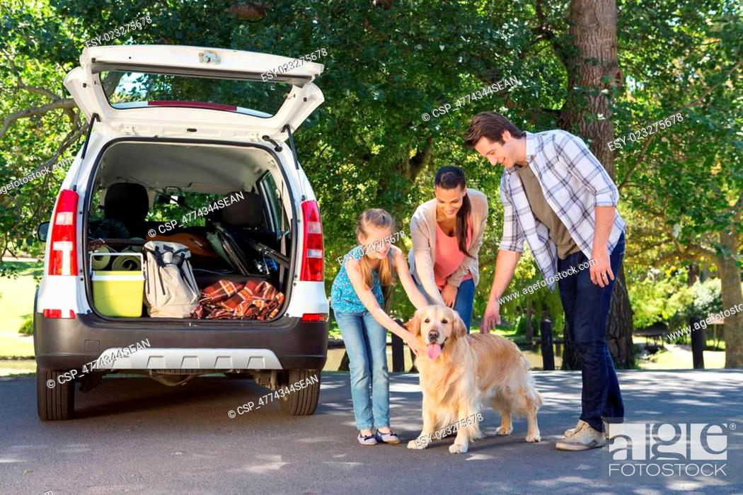 Stock Photo: Family getting ready to go on road trip.
