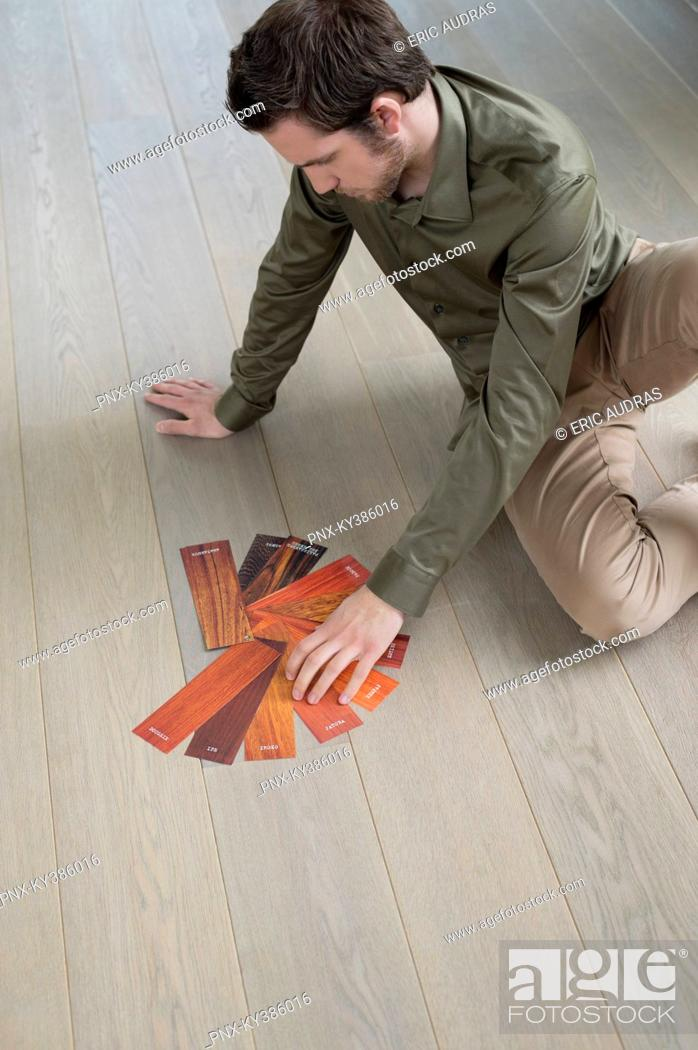 Stock Photo: High angle view of a man choosing laminate boards.