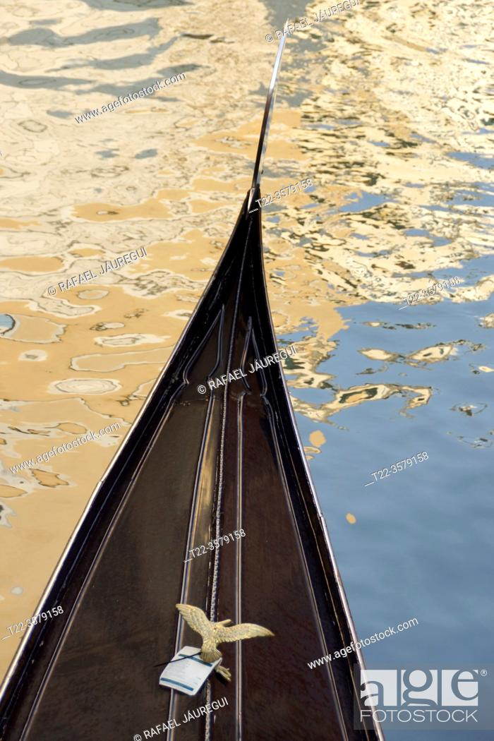Stock Photo: Venice (Italy). Detail of the bow of a Gondola in the city of Venice.