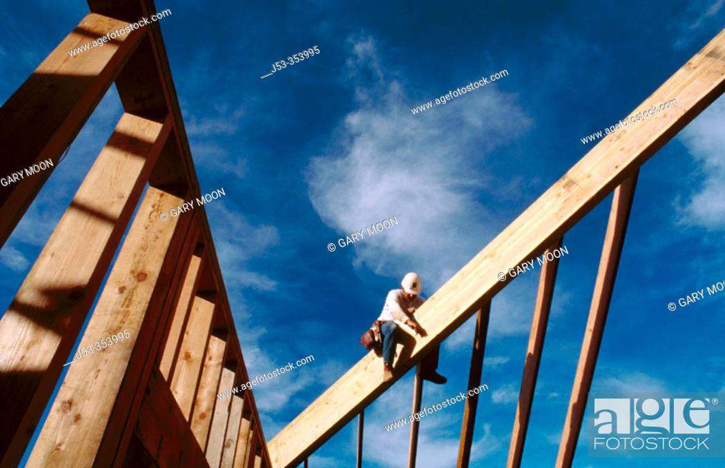 Stock Photo: Carpenter making rafters. Grass Valley. California. USA.