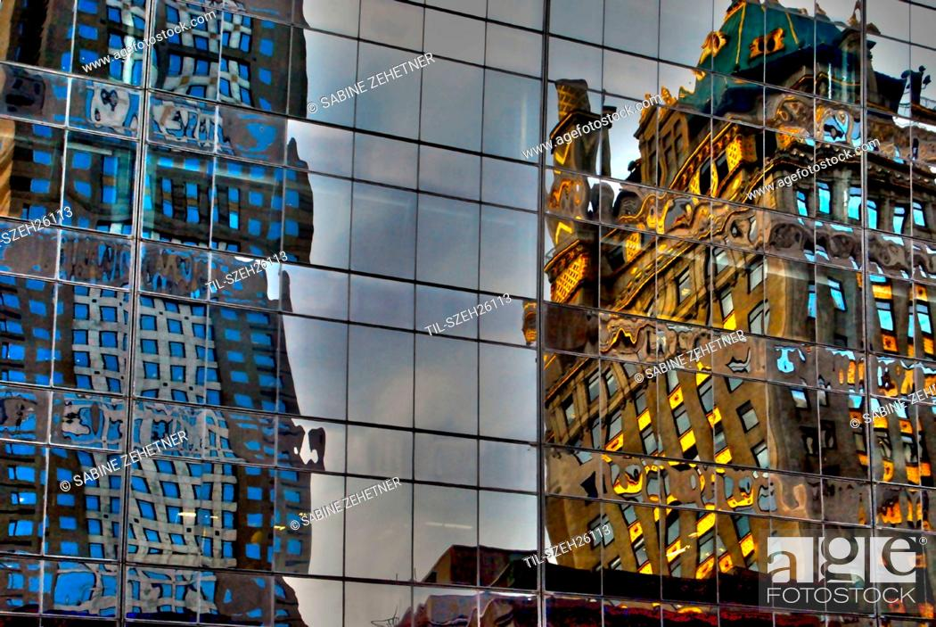 Stock Photo: Reflections of buildings in Midtown Manhattan in windows.