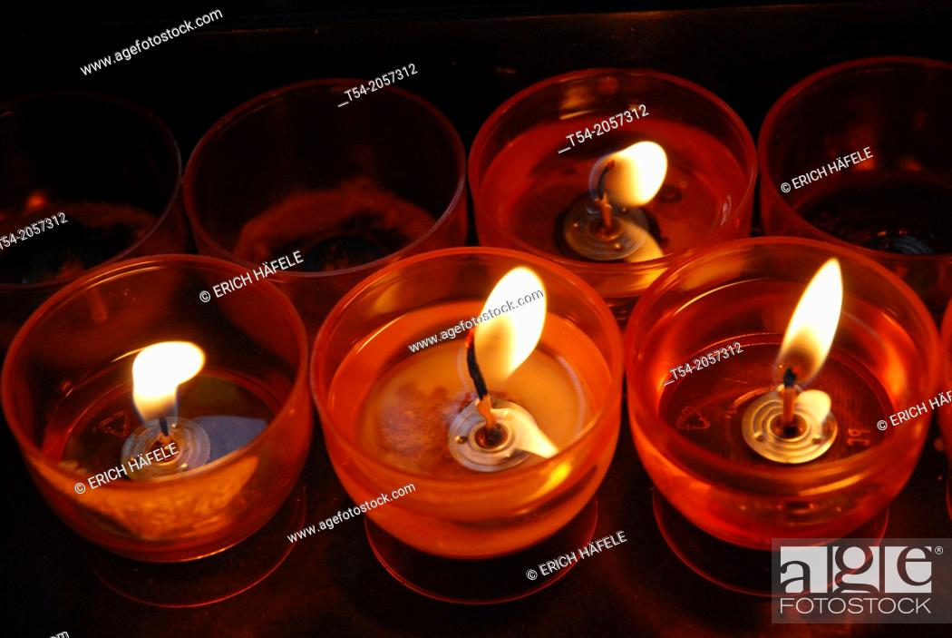 Stock Photo: Burning candles in a church.