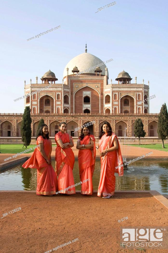 Stock Photo: Young Indian women in front of Humayun's Tomb, Delhi, India.