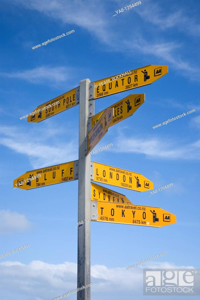 Stock Photo: Cape Reinga Aupori Peninsula Northland North Island New Zealand  AA Travel World destinations directions and distances signpost against blue sky.