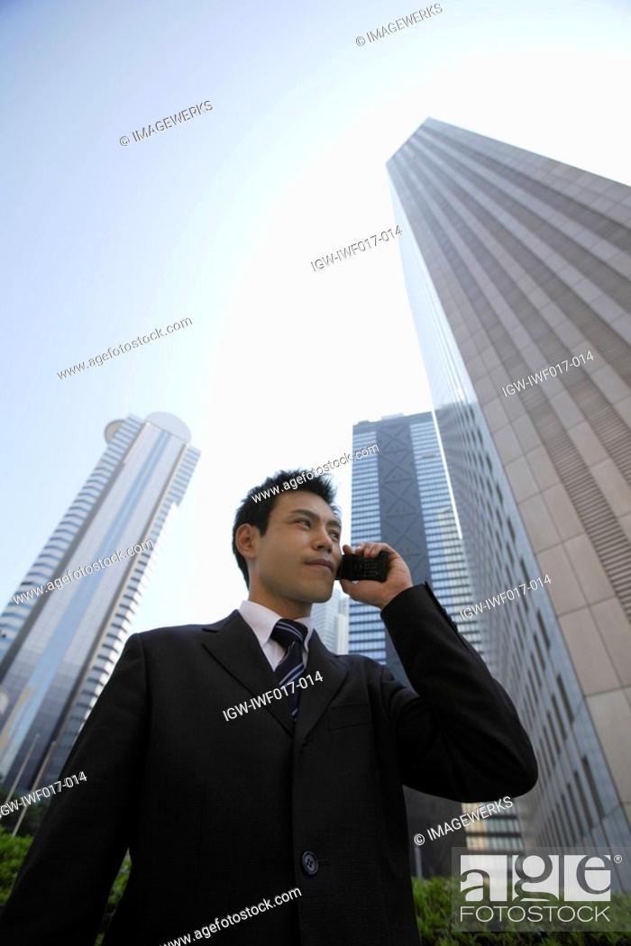 Stock Photo: Businessman conversing on a cellphone.