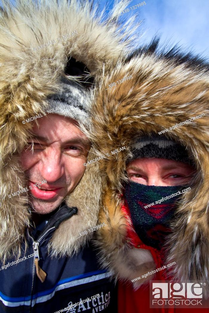 Stock Photo: Canadian photographer Gilles Pucheu and his wife Marianne in Arctic clothingk near their home in Yellowknife, Northwest Territories, Canada.