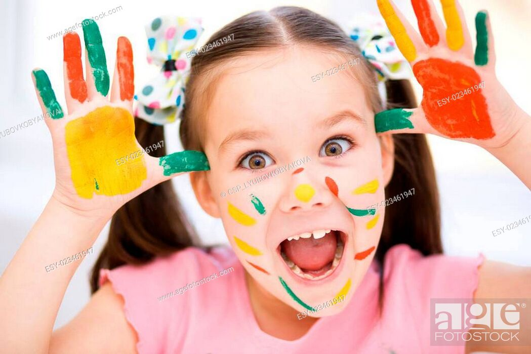 Stock Photo: Portrait of a cute girl playing with paints.