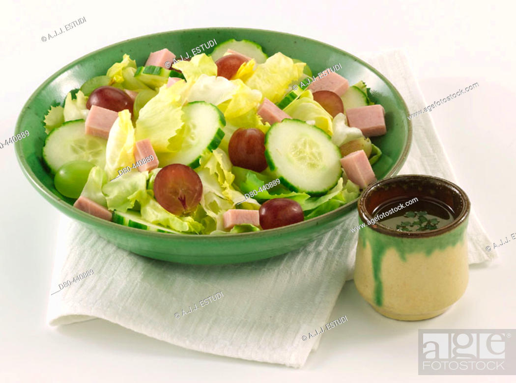 Stock Photo: Salad with grapes, cucumber and ham.