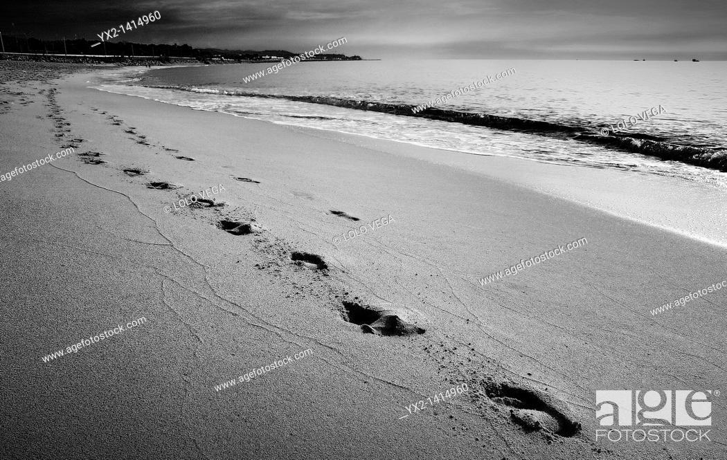 Stock Photo: Footprints in the sand on the beach, Mataro, Catalonia, Spain.