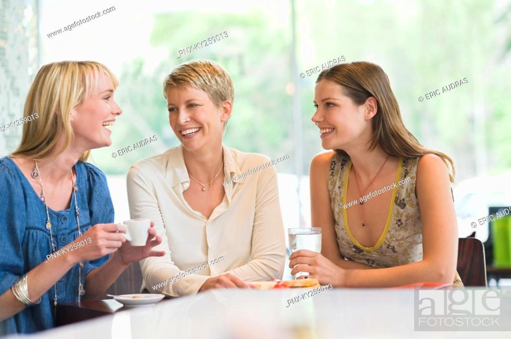 Stock Photo: Three women sitting in a restaurant.