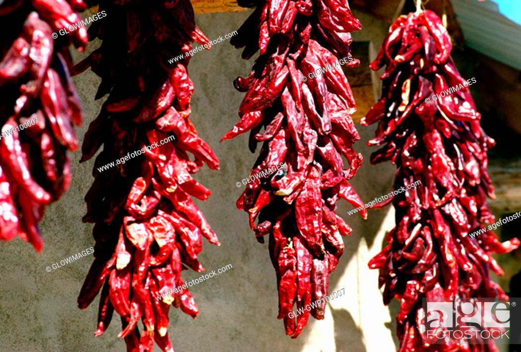 Stock Photo: Closeup of hanging dried red peppers.