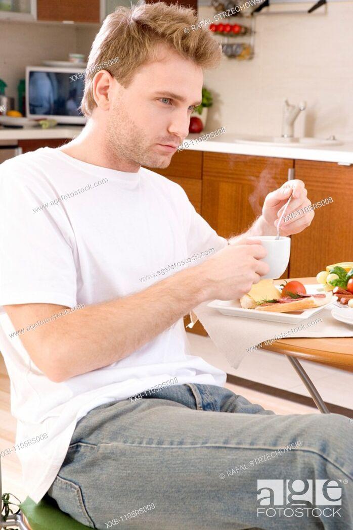 Stock Photo: sad man during breakfast.