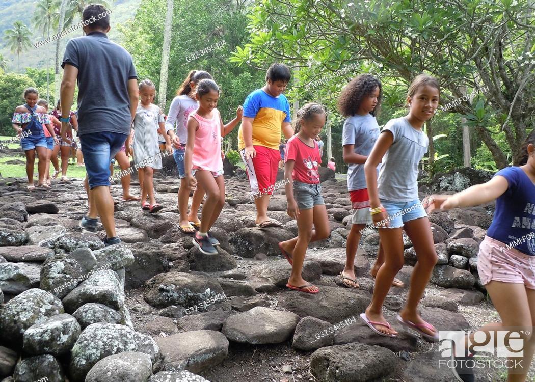 Stock Photo: schoolchildren with teachers visit Arahurahu marae, Tahiti, French Polynesia.