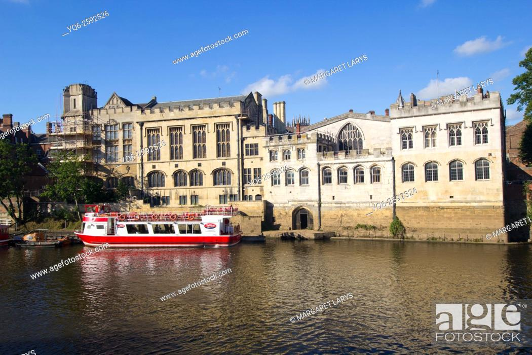 Stock Photo: River Ouse in York on a sunny day with a red tourists boat, North Yorkshire, England, United Kingdom.