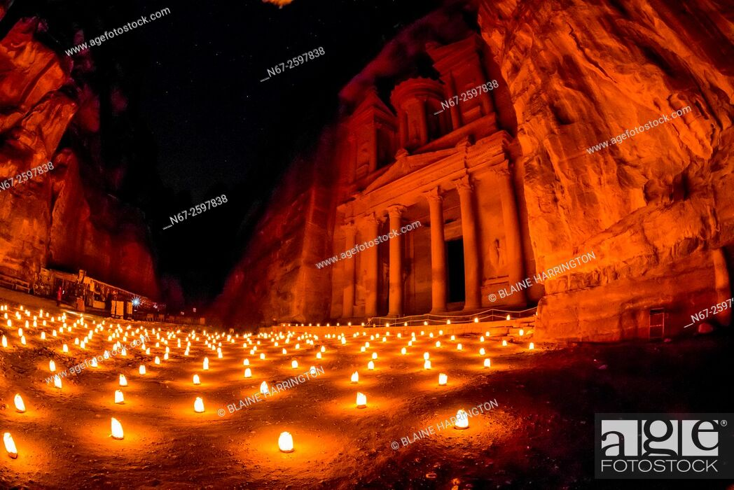 Stock Photo: Petra by night (candlelit), The Treasury monument (Al-Khazneh), Petra archaeological site (a UNESCO World Heritage site), Jordan.