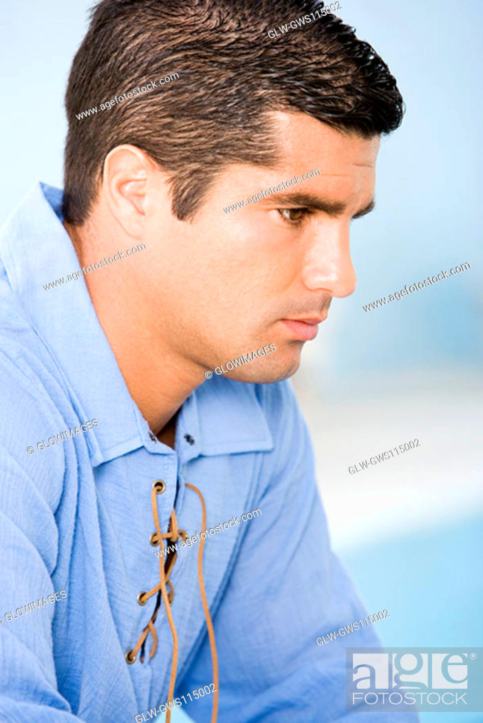 Stock Photo: Side profile of a mid adult man looking serious.