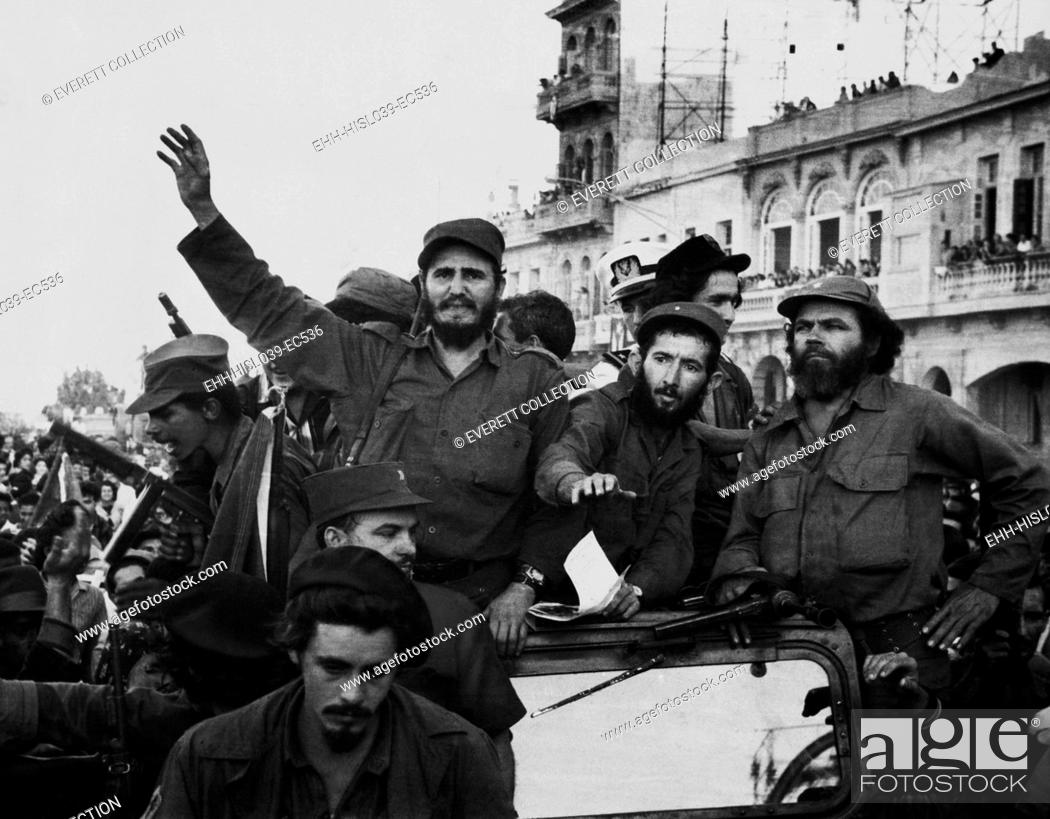 Stock Photo: Fidel Castro, with his fellow revolutionaries, entering Havana on January 8, 1959. They are surrounded by crowds of people after their overthrow of Fulgencio.