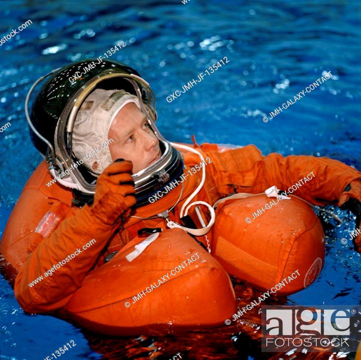 Stock Photo: Astronaut Steven W. Lindsey, STS-104 mission commander, floats in water during an emergency egress training session at the Neutral Buoyancy Laboratory (NBL).
