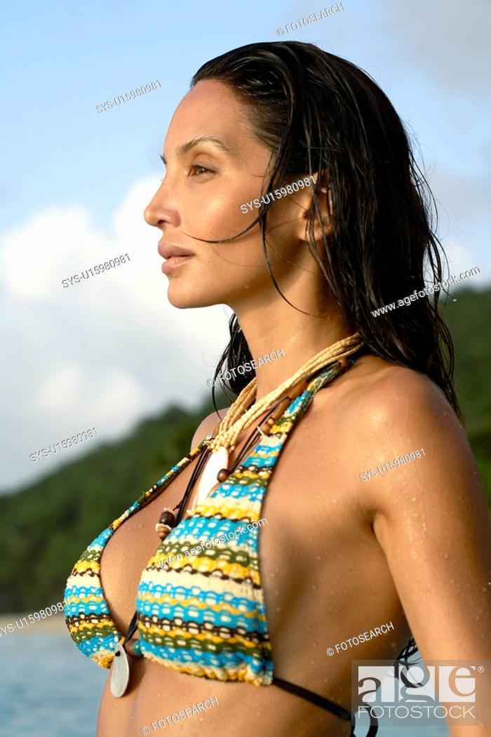 Stock Photo: Young woman in bikini at dusk.
