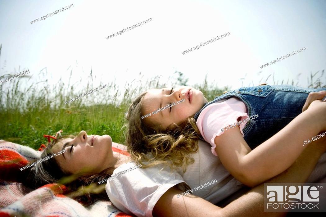 Stock Photo: Mother and daughter asleep.