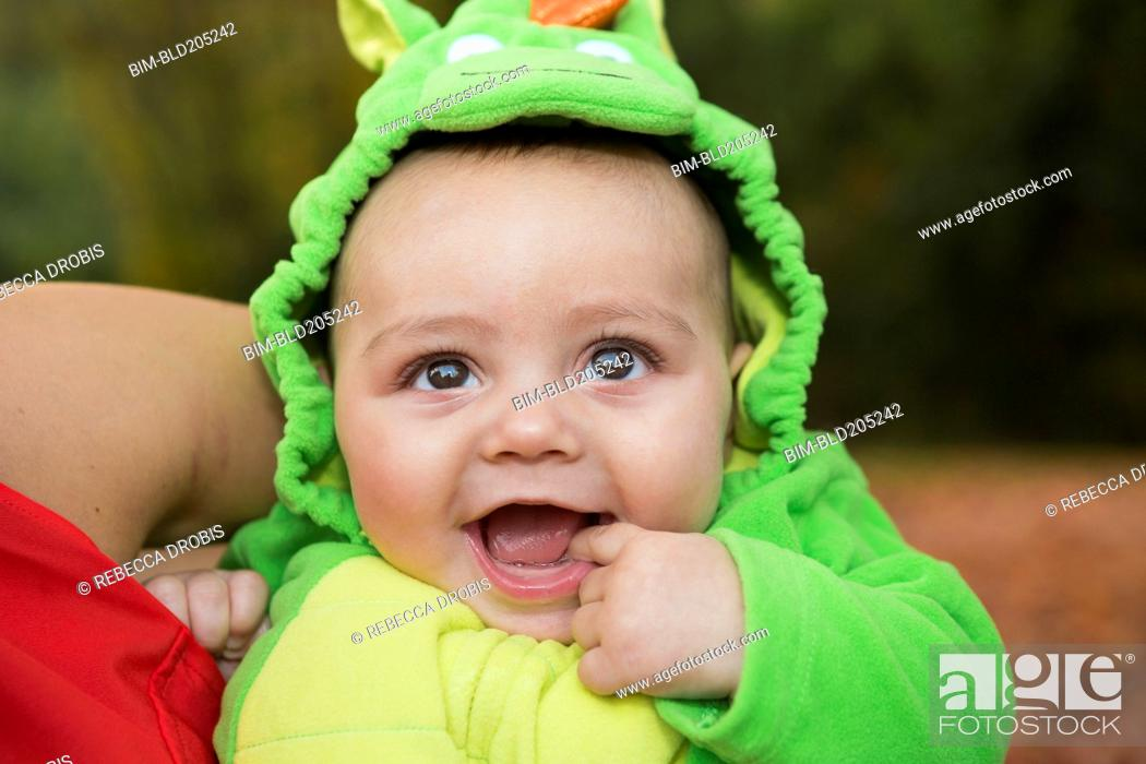 Stock Photo: Smiling baby wearing costume.