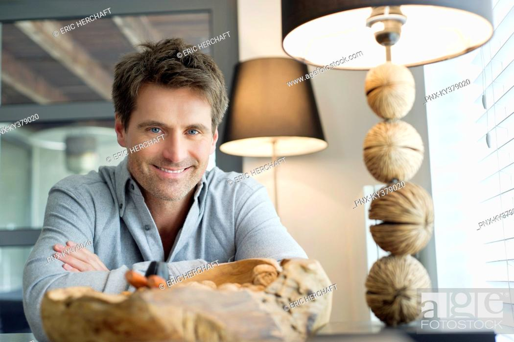 Stock Photo: Portrait of a man smiling at home.