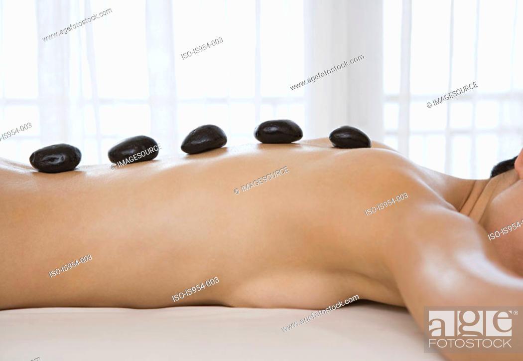Stock Photo: Woman having Lastone therapy.