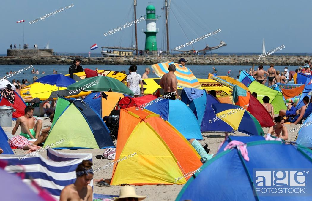 Stock Photo: Vacationers flock to a Baltic Sea beach in Rostock-Warnemuende, Germany, 03 August 2015. As school summer break has started in several German states.