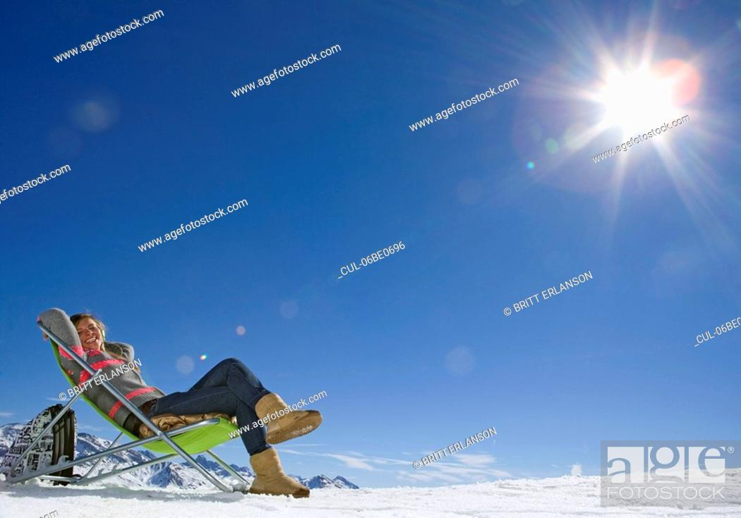 Stock Photo: Girl sitting in sunshine.