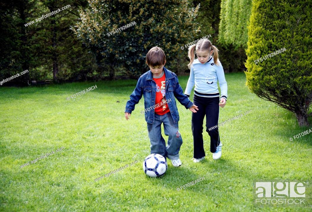 Stock Photo: Children playing soccer.