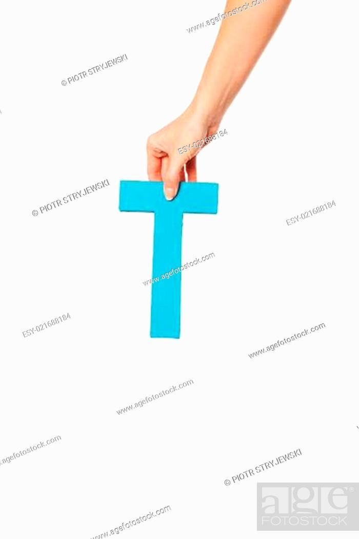 Stock Photo: hand holding up the letter T from the top.