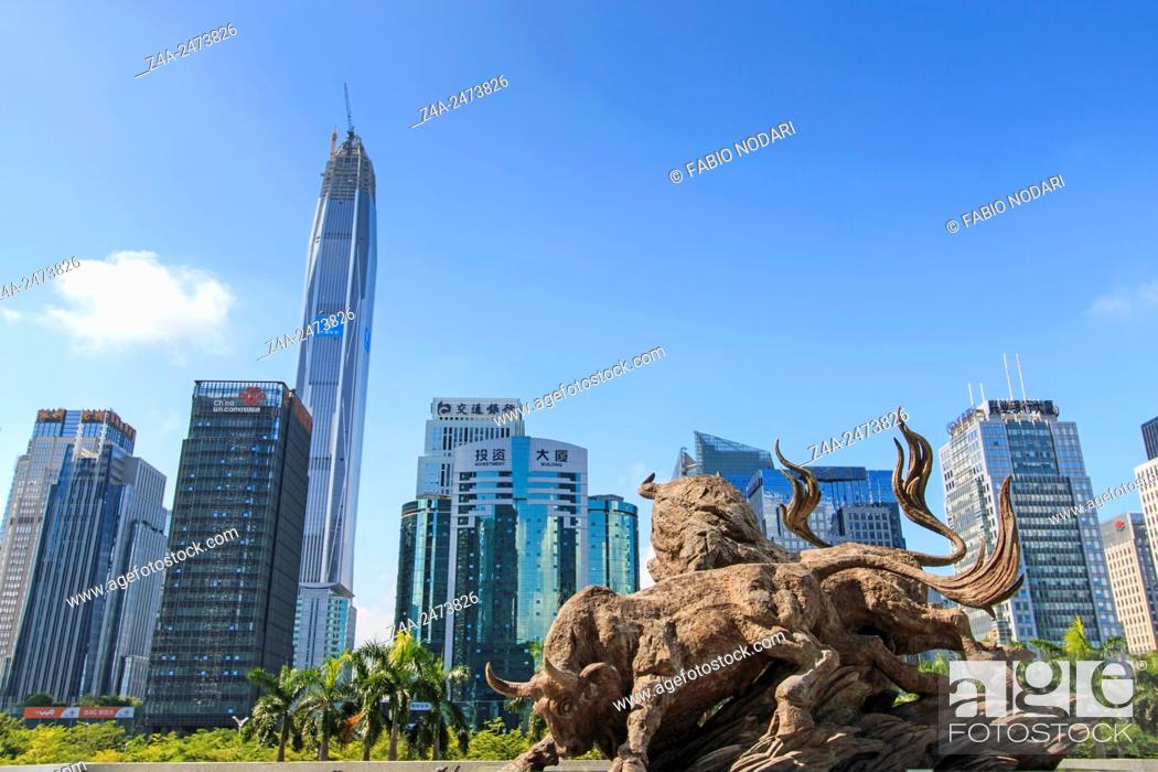 Stock Photo: Shenzhen, China - August 19, 2015: Stock market building in Shenzhen, one of the three stock markets in China, with the copper bull statue on foreground.