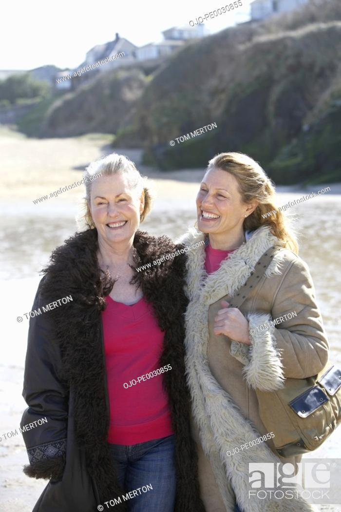 Stock Photo: one mature and one senior woman on the beach.