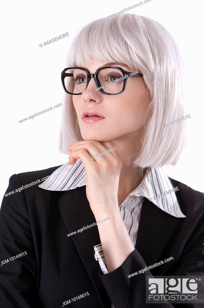 Stock Photo: Young businesswoman wearing glasses, thinking with head on hand.