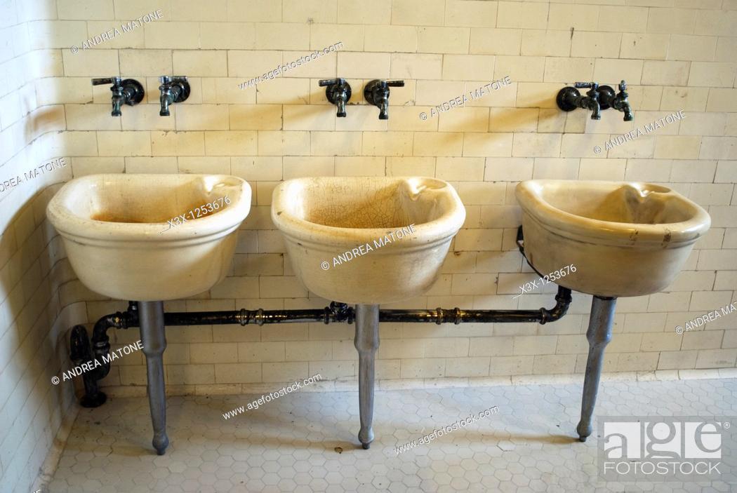 Stock Photo: Bathroom sinks used by immigrants in Ellis Island NYC USA.
