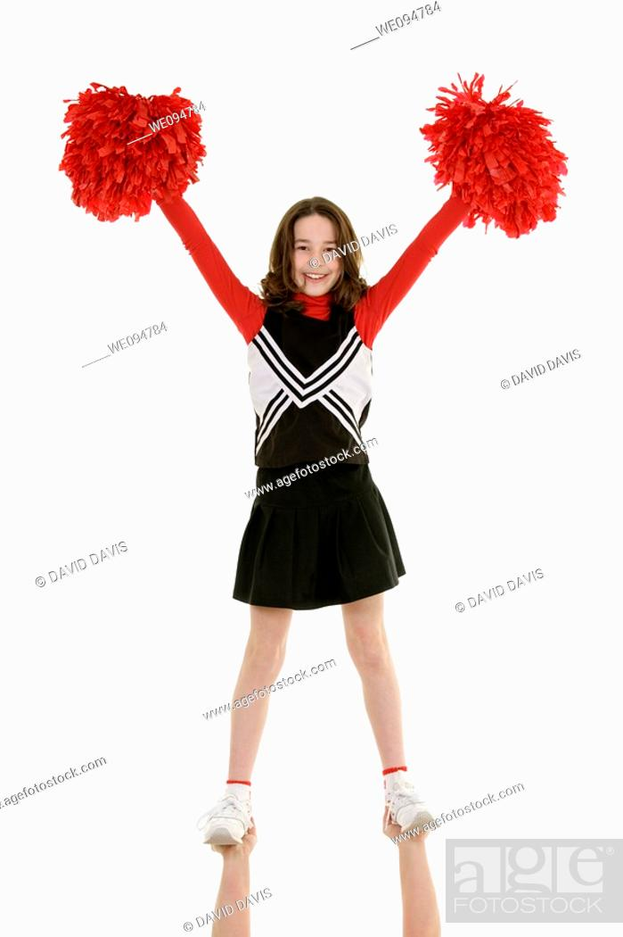 Stock Photo: Ten year old caucasian girl dressed as cheerleader.