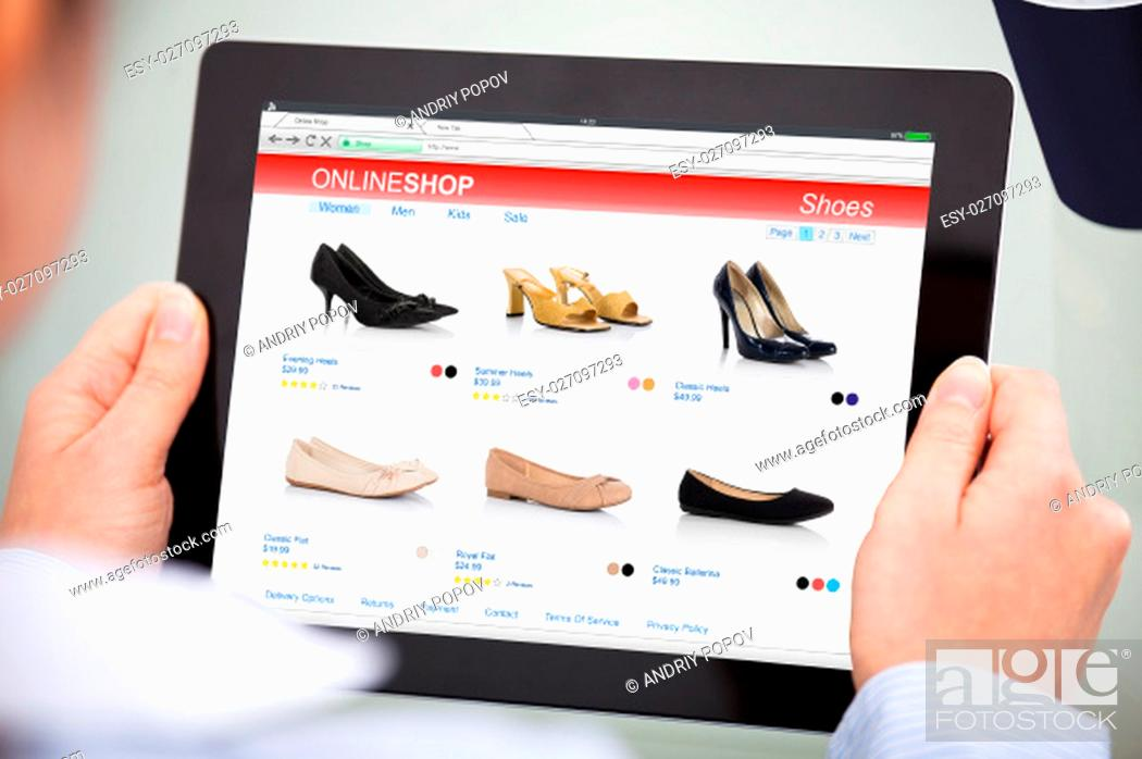 Stock Photo: Close-up Of Businesswoman Holding Blank Screen Digital Tablet And Disposable Cup.