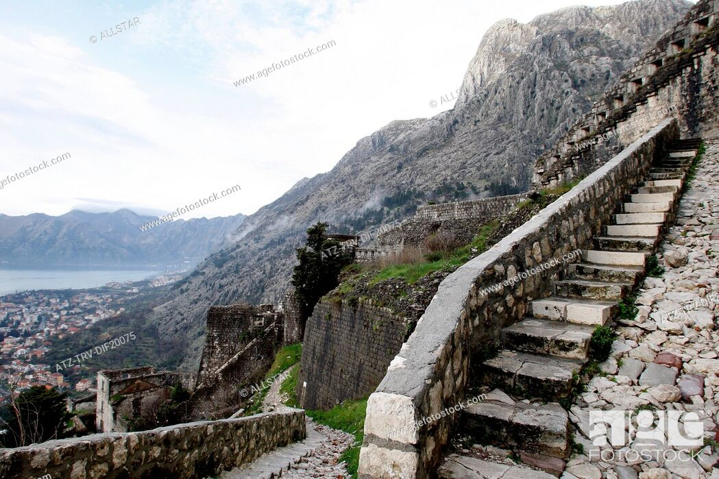 Stock Photo: STEEP PATH UP FORTRESS WALLS & KOTOR OLD TOWN; KOTOR, MONTENEGRO; 25/03/2013.