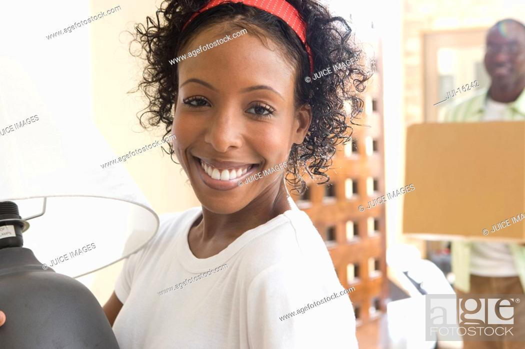 Stock Photo: Woman moving into new house.
