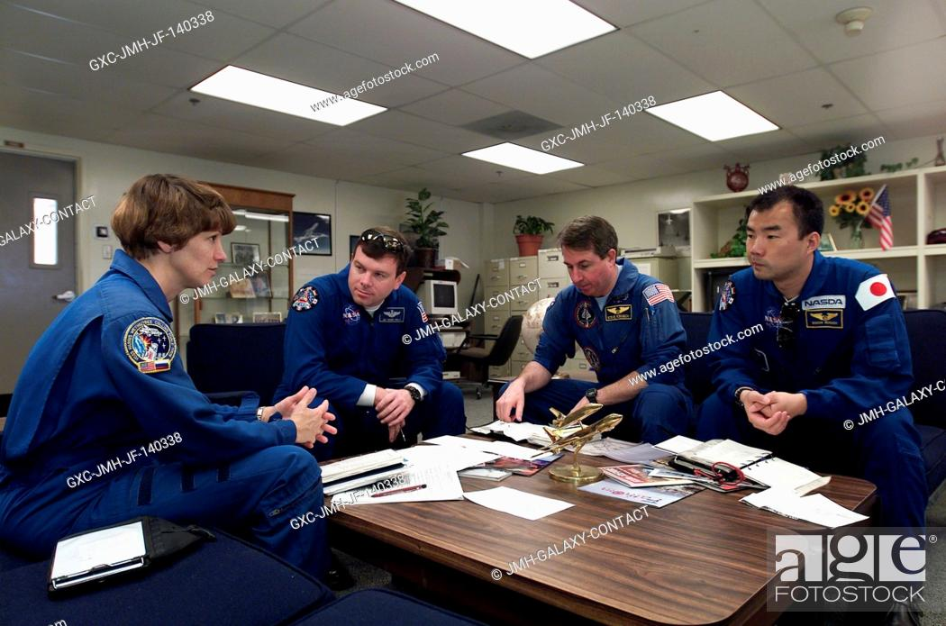Stock Photo: The STS-114 crewmembers are photographed during a briefing prior to a flight in T-38 trainer jets at Ellington Field near Johnson Space Center (JSC).